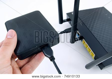 Router with backup storage disk. DLNA media server from USB disk poster