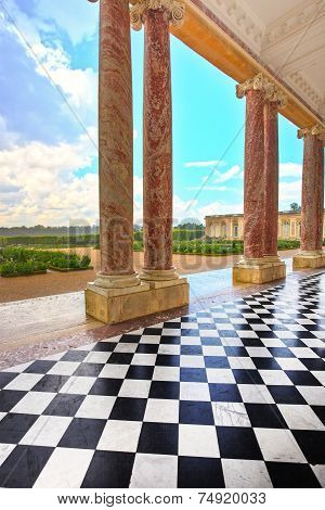 Grand Trianon Courtyard And Columns And Garden In Palace Of Versailles, Paris, France.