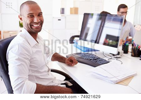 Businessman At Computer In Office Of Start Up Business