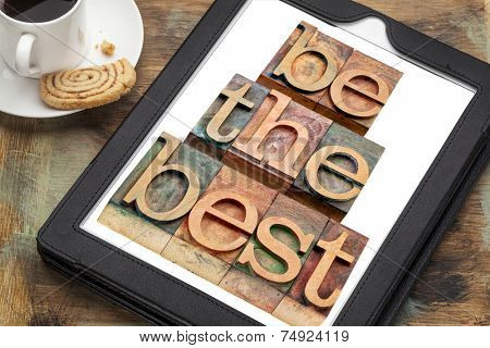 be the best - text in letterpress woodtype on a digital tablet with a cup of coffee - motivation concept