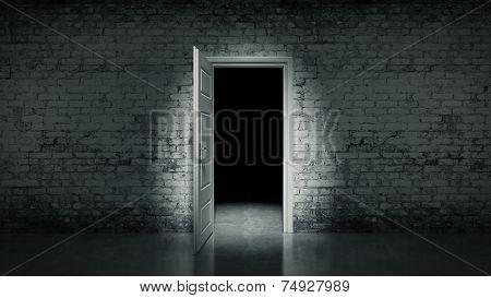 open door in a white vintage brick wall