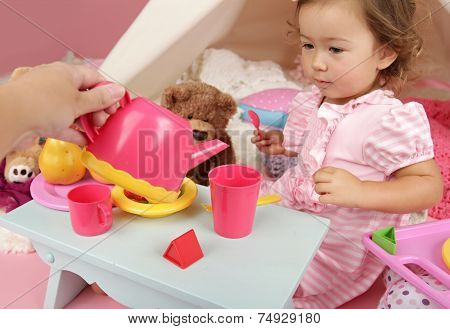 Parent Or Friend Playing With Kids At Home: Toddler Tea Party