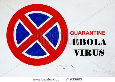 White Wall With Signpost And Text Quarantine Ebola Virus