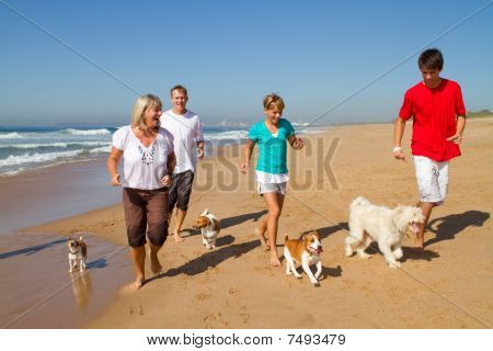 active family on beach with pets
