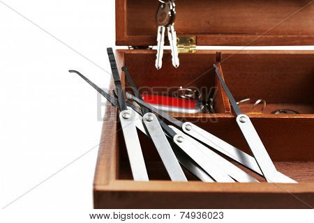 Set of keys and lock picks in wooden box close-up