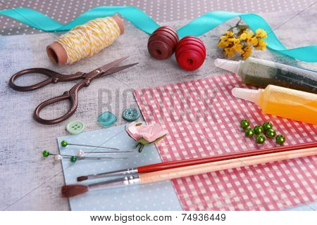 Scrapbooking craft materials on bright background poster