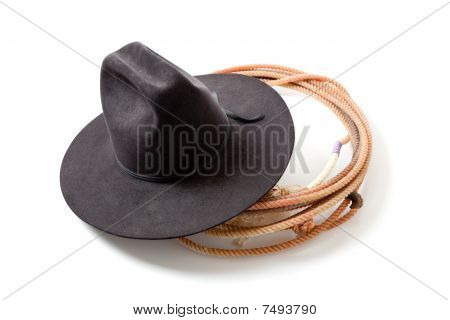A Cowboy Hat And Lariat On White