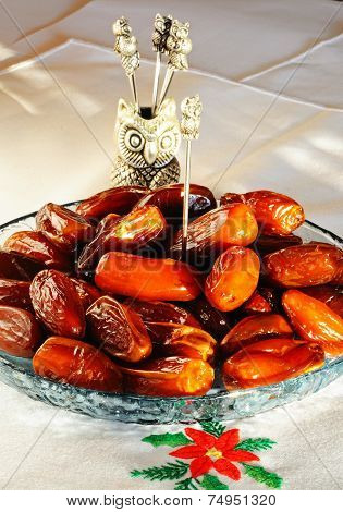 Dates in a glass dish.