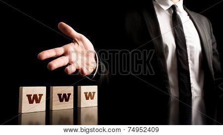 Man Representing Wooden Pieces With Www Letters