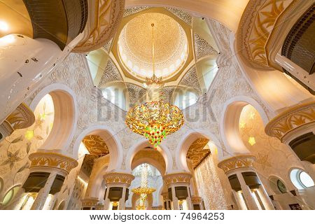 ABU DHABI, UAE - 26 MARCH 2014: Interior of Sheikh Zayed Grand Mosque in Abu Dhabi, United Arab Emirates. Mosque has many unique elements like 12 tons chandelier covered by gold and Swarovski crystals