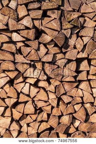 Stacked firewood of spruce in vertical format poster