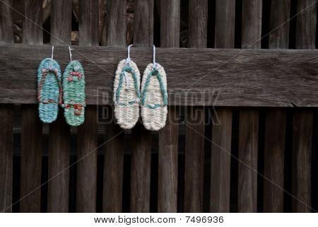 Two Traditional Woven Cloth Japanese Sandals (zori) Hung On A Temple Wall