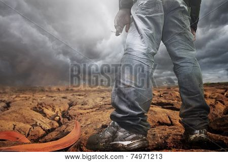 Man standing on dry earth texture at thailand