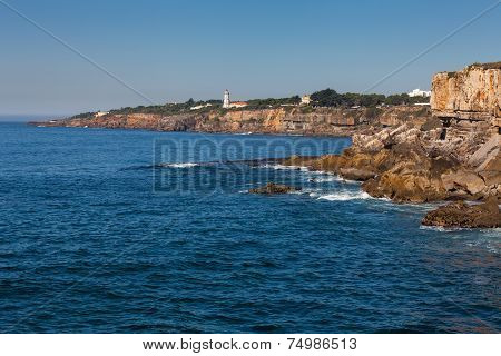Rocky Coastline With Lighthouse