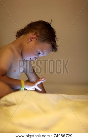 Child On Bed With Pocket Pc