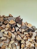 Stacked logs firewood natural pattern background, biomass poster