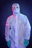 Scientist in Hazmat suit and protective gear over blue background poster