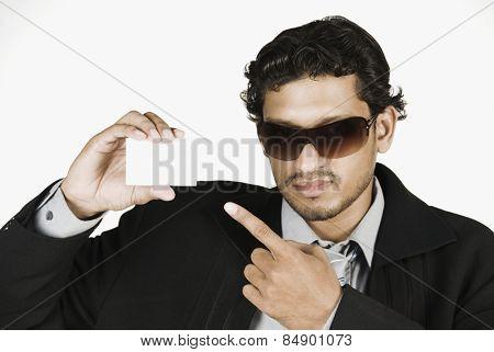 Businessman holding a blank placard