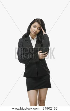 Businesswoman with her hand in hair