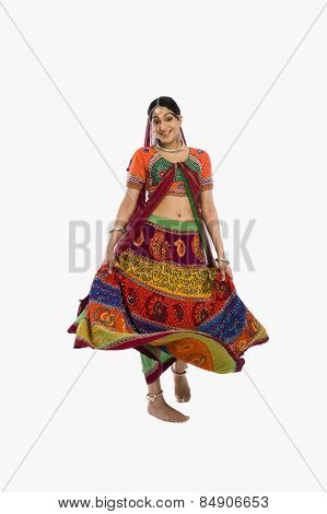 Woman dancing in colorful lehenga choli