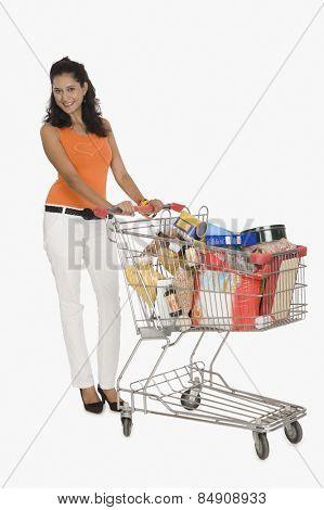 Portrait of a woman pushing a shopping cart
