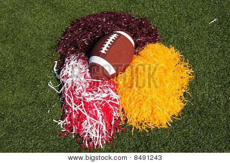 American Football And Pom Poms On Field