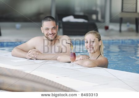 Happy Cople Relaxing  At Swimming Pool