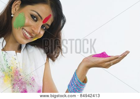 Portrait of a woman holding Holi colors