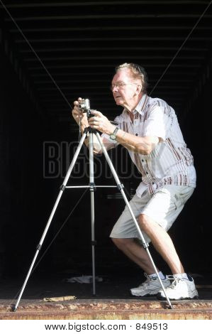 Old Man Taking A Picture