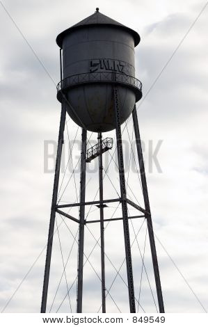 Abandoned Water Tower Against Cloudy Sky