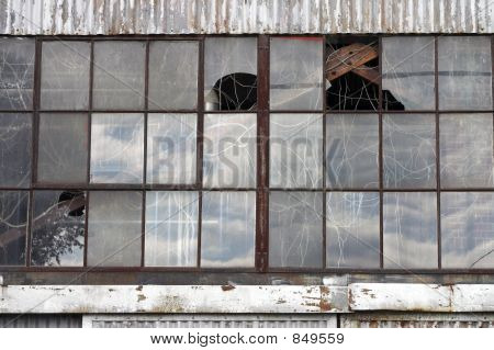 Broken Windows At Abandoned Factory Building