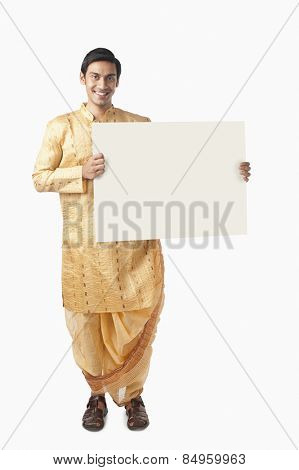 Bengali man holding a blank placard poster
