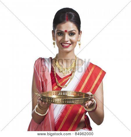 Traditional Bengali woman holding pooja thali poster