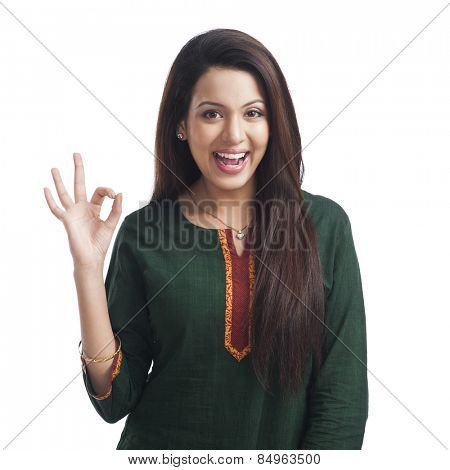 Portrait of a woman showing ok sign and smiling