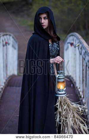 Girl With A Lantern On The Bridge