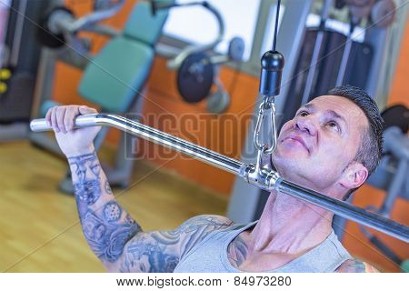 Young Man Making Pull Downs - Workout Routine .