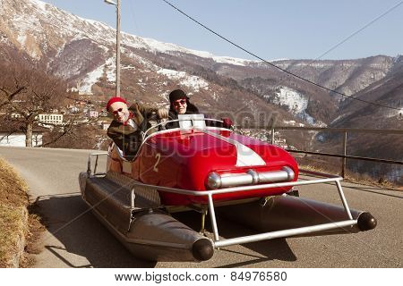 Elderly couple on a pedalo on a road. Situation unreal, surreal poster