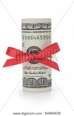 rolled wad of dollars tied with ribbon bow