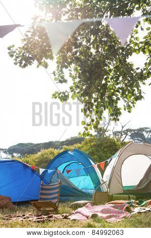 Empty campsite at music festival on a sunny day poster