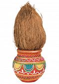 Close-up of a kalash with a coconut poster