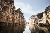 Marble rocks alongside Narmada River, Bhedaghat, Jabalpur District, Madhya Pradesh, India poster