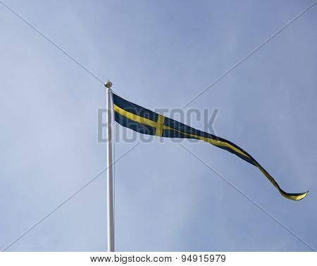 Swedish Pennent Waving On Flagpole