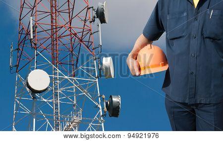 Engineer Holding Orange Helmet On Telecommunications Tower