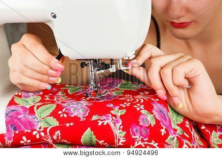 Seamstress Sew Fabric On The Sewing Machine.