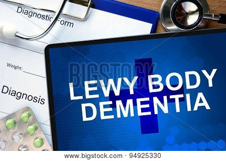 Diagnosis Lewy body dementia and tablets on a wooden table. Medicine concept. poster