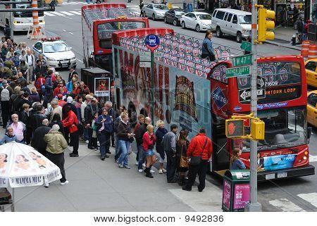 Tourists Boarding Double Decker Buses