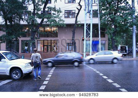 Drunk Man Crossing Road In The Rain poster