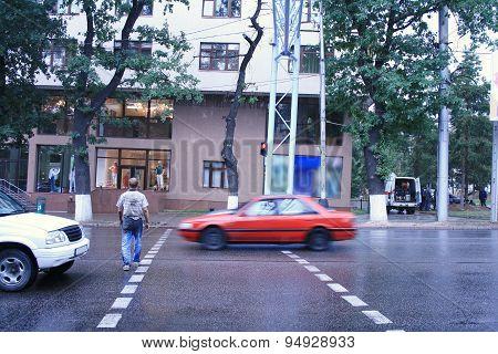 Drunk Man Crossing Road In The Rain