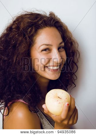 pretty young real tenage girl eating apple close up