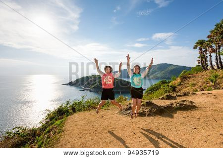 Two Girls Mother And Daughter Jumping